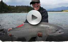 Picture of a smiling man holding a large Skeena River Steelhead